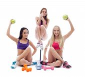 Funny sportswomen posing with sports equipment