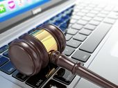Online auction. Gavel on laptop. Conceptual image. 3d