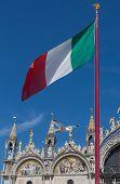 Italian Flag And Saint Mark's Basilica