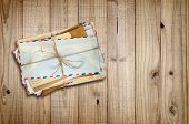 Pile Of Old Envelopes On Wooden Background