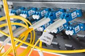 stock photo of node  - server with fiber optic  cables in data center - JPG