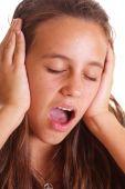 Teen Girl Holding Ears