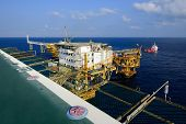 The Offshore Oil Rig Platform And Supply Boat