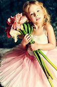 image of tutu  - Pretty little girl ballerina in tutu posing over vintage background - JPG