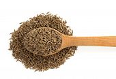 cumin seeds in spoon isolated on white background