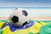 Soccer Ball Above Brazilian Flag