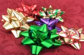 Colorful Christmas Bows On A Red Background