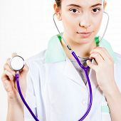 Doctor holding stehohscope close up