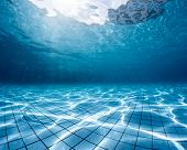stock photo of swimming  - Underwater shot of the swimming pool - JPG