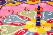 stock photo of deepavali  - Colorful Indian kolam during a Deepavali celebration - JPG