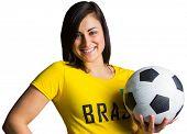 Pretty football fan in brasil tshirt on white background