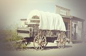 stock photo of wagon wheel  - Western wagon and cowboy town general store - JPG