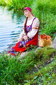 Woman in dress suit stylized Ukrainian folk