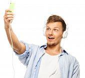 Stylish happy man in headphones taking selfie isolated on white