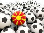 stock photo of macedonia  - Football with flag of macedonia in front of regular balls - JPG