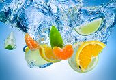 Tropical Fruits Fall Deeply Under Water With A Big Splash