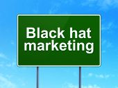 Finance concept: Black Hat Marketing on road sign background