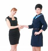 Business women smiling and doing a handshake