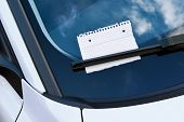 stock photo of wiper  - sheet of paper under a windshield wiper  - JPG