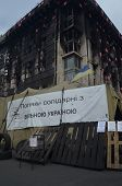 KIEV, UKRAINE - APR 7, 2014: Burned downtown of Kiev with poster - Poland agree with protesters ( Uk