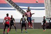 CARSON, CA - APRIL 6: Los Angeles Galaxy D Omar Gonzalez (4) & Chivas USA F Luke Moore (19) during t