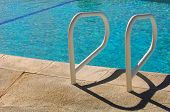 Background Image of a Common Pool Ladder by The pool