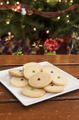 stock photo of shortbread  - Plate of shortbread cookies in front of the Christmas tree - JPG