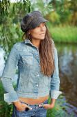 Attractive Young Woman Dressed In Jean Jacket And Beret
