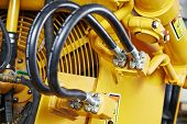 stock photo of machinery  - Hydraulic pressure pipes system of construction machinery - JPG