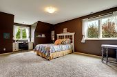 Master Bedroom In Dark Brown Color With Office Area