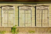 Three old vintage windows in traditional Russian style in Astrakhan, Russia. Front view, closed shut