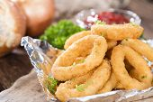 Onion Rings On Wooden Background