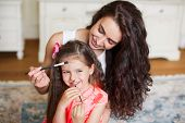 picture of tickle  - Mother and daughter having fun painting at home - JPG