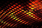 Intriguing abstract techno background with elements of metal, made in contrasting black and red