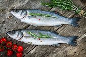 Two Raw Seabass With Cherry Tomatoes And Rosemary