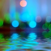 Reflection in water Bokeh background light blue color
