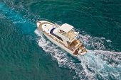 Yacht Sailing On Sea Aerial View