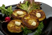 image of hash  - Hash browns with herbs on the plate - JPG