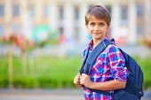 Portrait Of Cute Schoolboy With Backpack, Outdoors