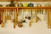 Kitchen Ware Hanging On The Wall.