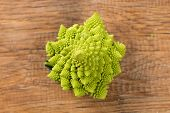 stock photo of romanesco  - Tasty Lone romanesco on a wooden board - JPG
