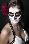 Woman With Makeup Of La Santa Muerte With Red Roses In Front Of  Black Background