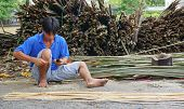 The man making a bamboo basket