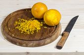 Two Orange And Zest On Wooden Cutting Board