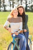 Two cheerful girls during cycling