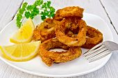 Calamari Fried With Lemon On Plate