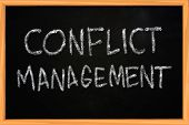 Conflict Management Chalk Writing On Blackboard