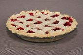 picture of cherry pie  - A whole cherry pie in a glass pie plate. ** Note: Soft Focus at 100%, best at smaller sizes - JPG