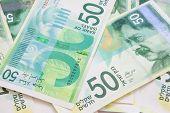 stock photo of shekel  - Various new Israeli shekel notes background image - JPG