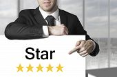 Businessman Pointing On Sign Star Golden Rating